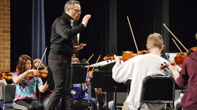 Elgin Symphony Orchestra conductor coaches Larkin students, encourages love of music