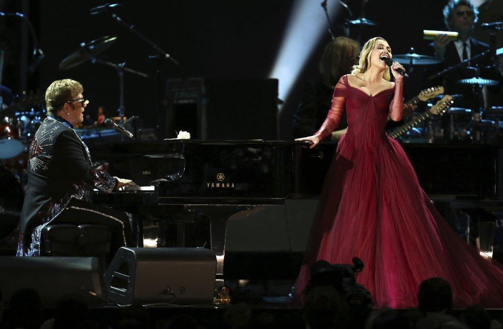 "Elton John and Miley Cyrus played it safe with their duet of ""Tiny Dancer."" (Matt Sayles / Invision / Associated Press)"