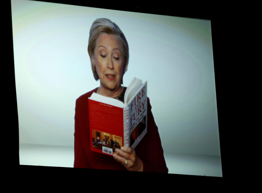 "Hillary Clinton appears onscreen reading an excerpt from the book ""Fire and Fury"" during a skit at the Grammys. (Matt Sayles/Invision/AP)"