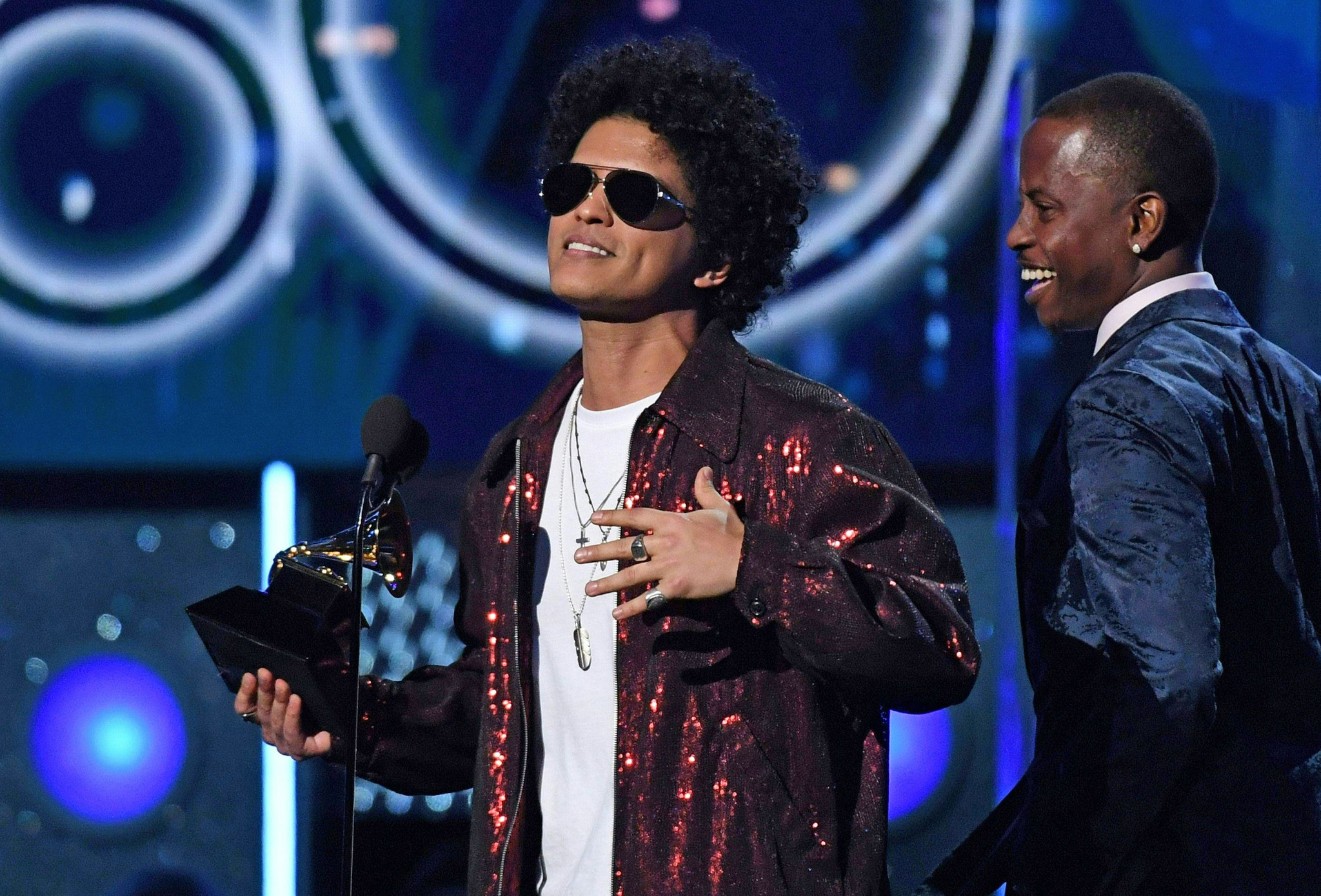 Bruno Mars receives the Grammy for record of the year during the 60th Grammy Awards show on Jan. 28, 2018. (Timothy A. Clary / AFP / Getty Images)