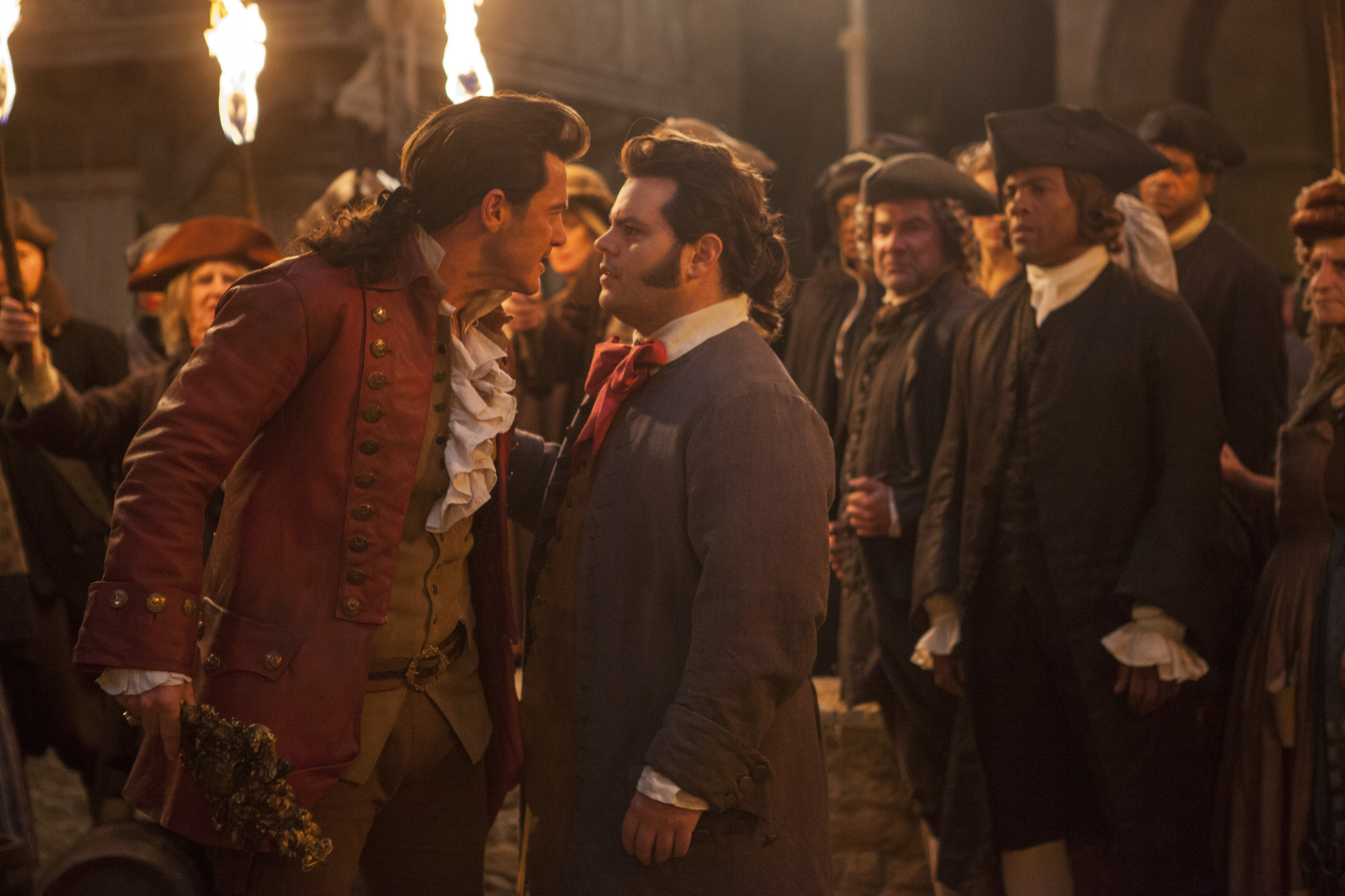 """Luke Evans as Gaston, left, and Josh Gad as LeFou in """"Beauty and the Beast."""""""