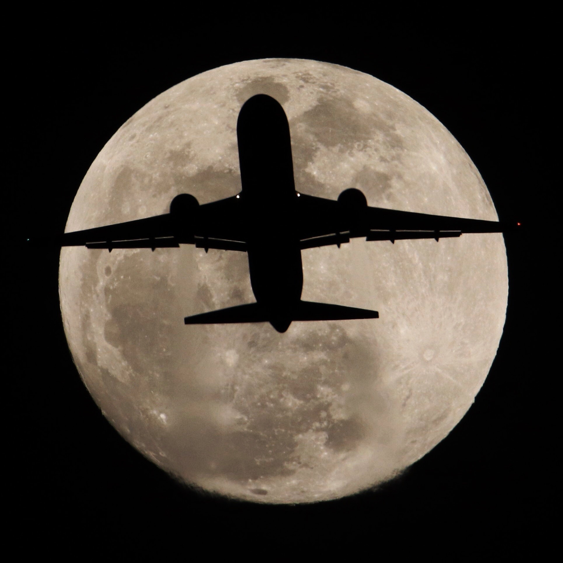 Jan. 30, 2018: Airliner crosses in front of full moon over Whittier, California, Tuesday evening. Th