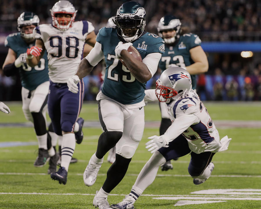 Eagles running back LeGarrette Blount breaks into the Patriots' secondary on a 21-yard touchdown run during the second quarter. (Chris O'Meara / Associated Press)