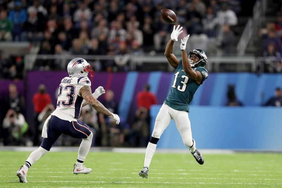 Eagles receiver Nelson Agholor (13) makes a catch over Patriots defensive back Patrick Chung (23) during the fourth quarter in Super Bowl LII. (Patrick Smith / Getty Images)
