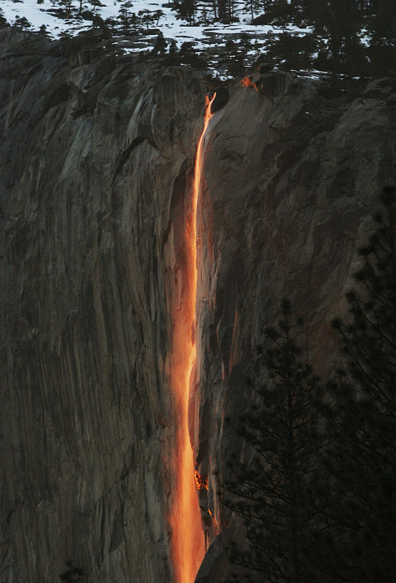 "A shaft of sunlight creates a glow near Horsetail Fall in Yosemite National Park. Mid-February is prime time to see the ""natural fire fall."""
