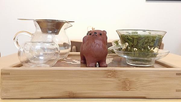 Dragonwell tea and a clay tea pet
