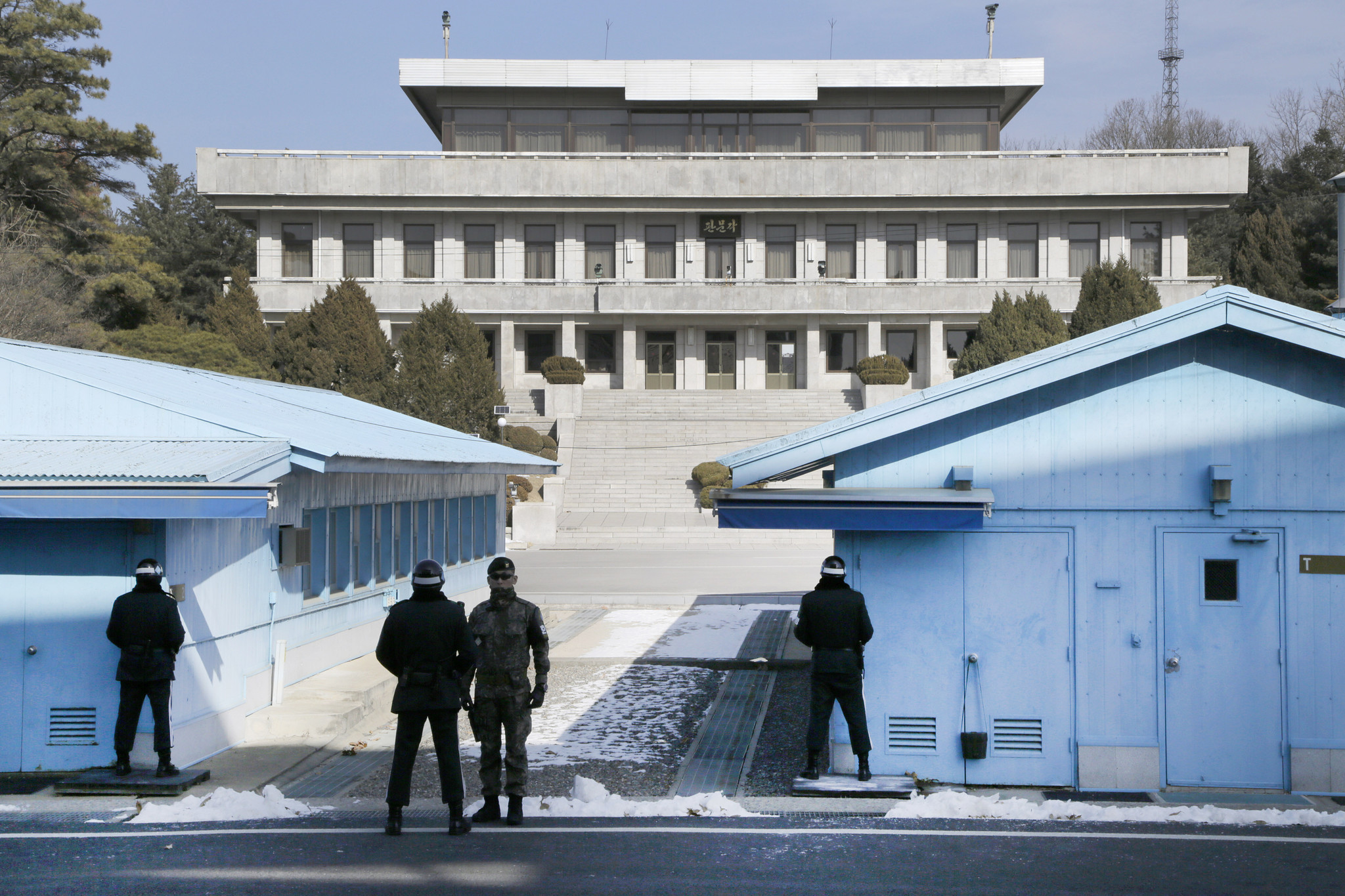 SOUTH KOREA FEBRUARY 6, 2018 -- South Korean Solders stand in front of huts in the Joint Security A