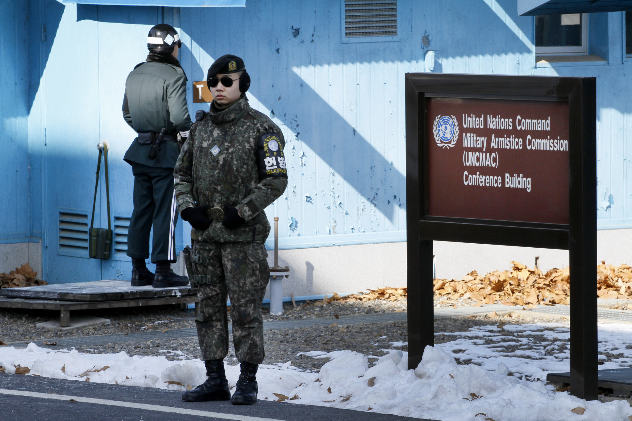 SOUTH KOREA FEBRUARY 6, 2018 -- South Korean Army member in front and South Korean Military Police