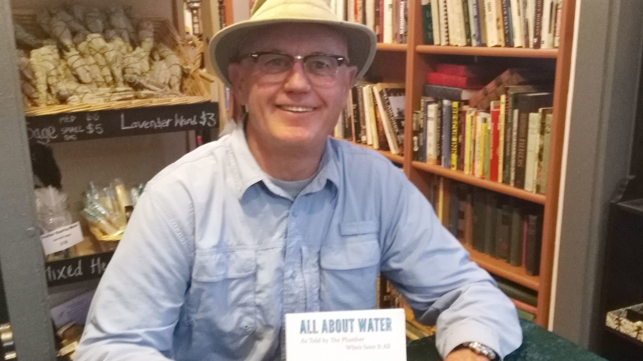 "Ramona's Plumber owner Greg Chick explains topics in his new book, ""All About Water as Told by The Plumber Who's Seen It All,"" at a book-signing Feb. 7 in Unicorn Books and Gifts."