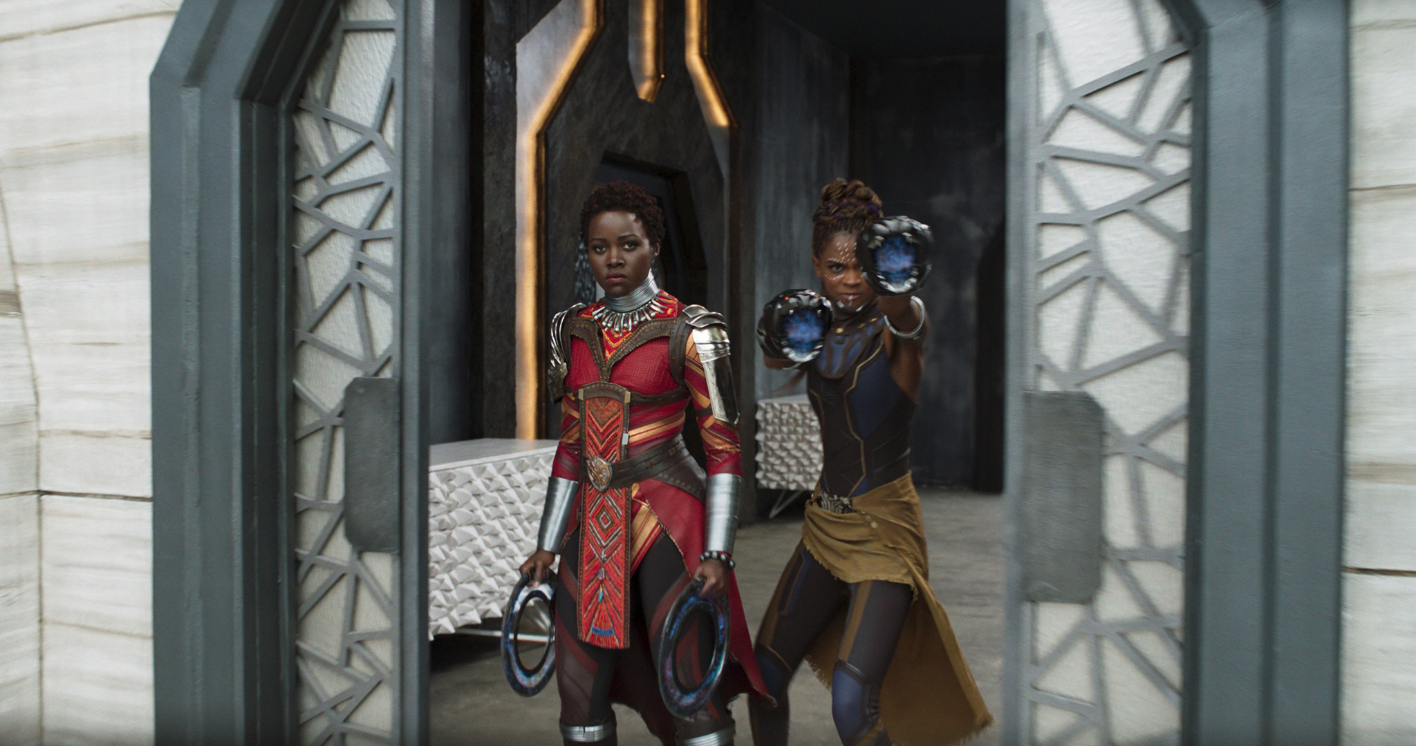 "(L-R) - Nakia (Lupita Nyong'o) and Shuri (Letitia Wright) in a scene from Marvel's ""Black Panther."""