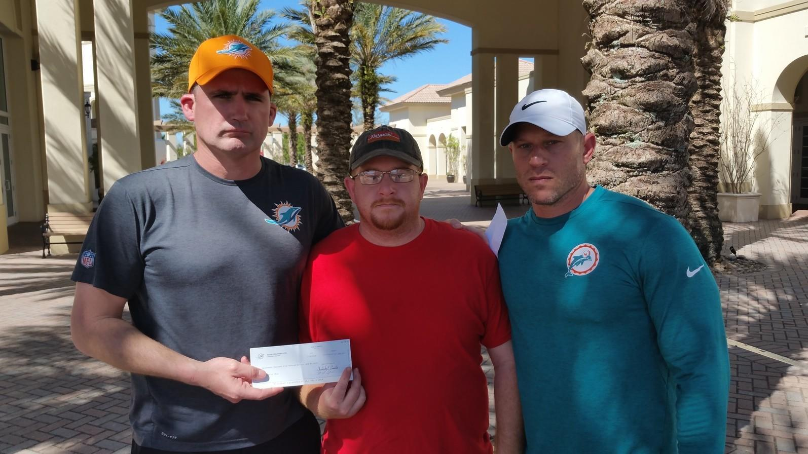 Fl-sp-shooting-victim-coach-feis-dolphins-donation-20180216