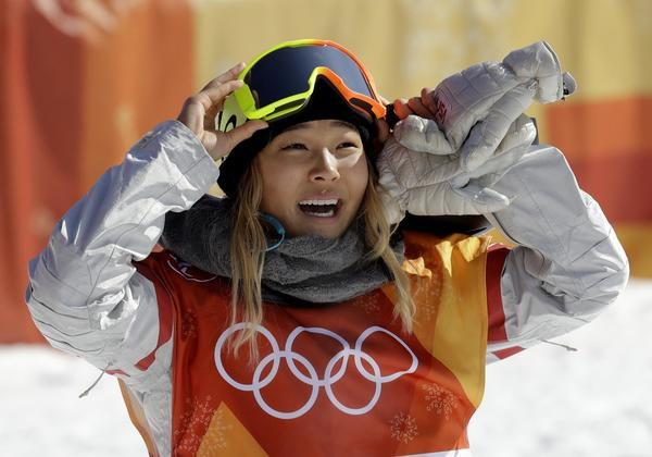 Chloe Kim will be featured during today's Winter Olympics review. (Lee Jin-man / Associated Press)