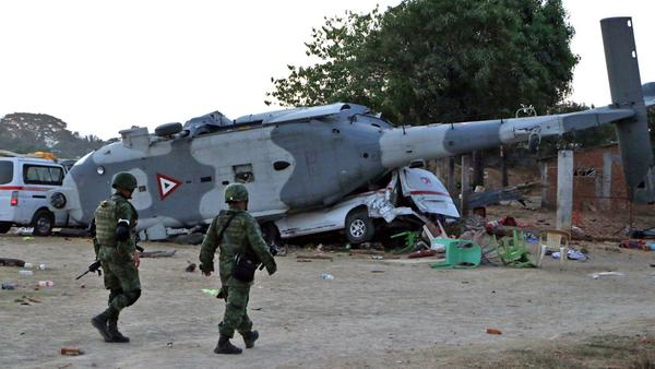 Military helicopter crashes in Mexico, killing 14 quake survivors on the ground