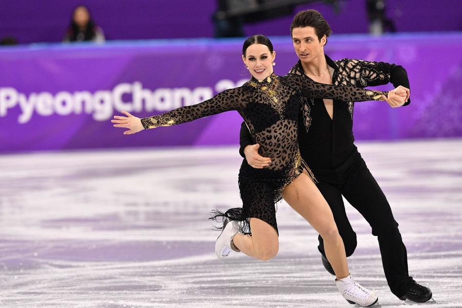 French ice dancers shake off costume mishap