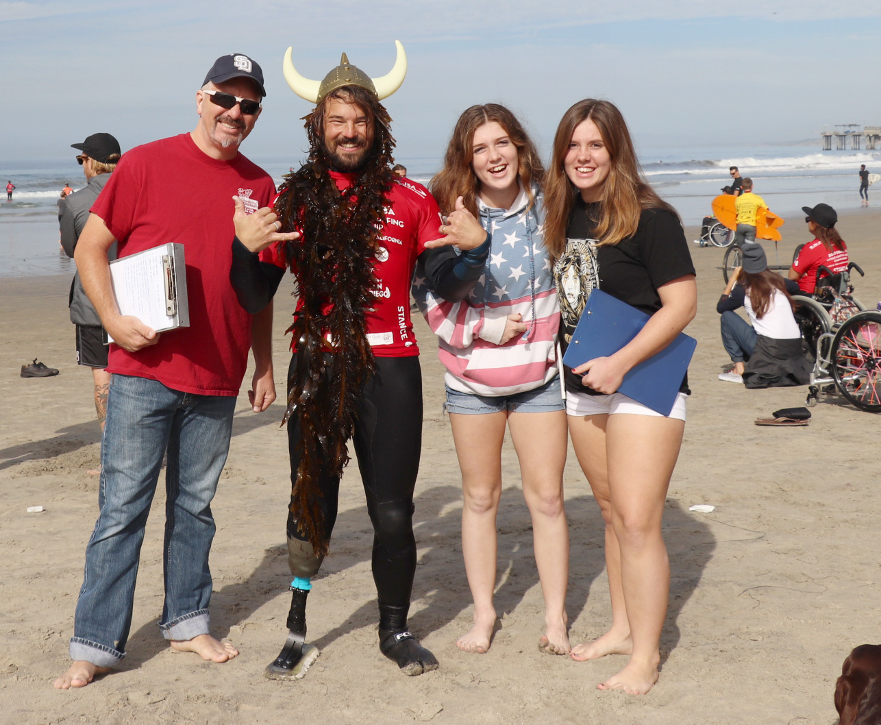 Shad, Coco and Shyla Bradley enjoy the 2017 Stance ISA World Adaptive Surfing Championship with Ismael Guillorit, one of its participants.