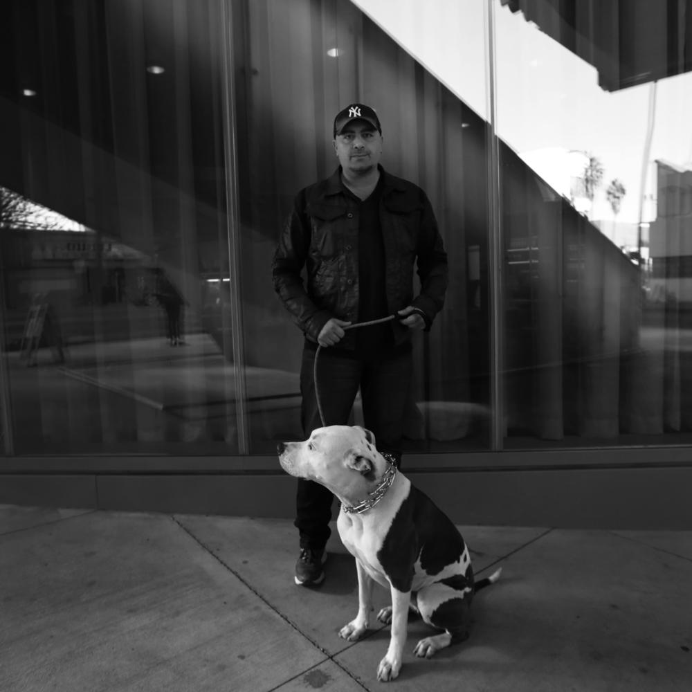 George Abou-Daoud with his dog Hudson at one of his restaurants in Hollywood.