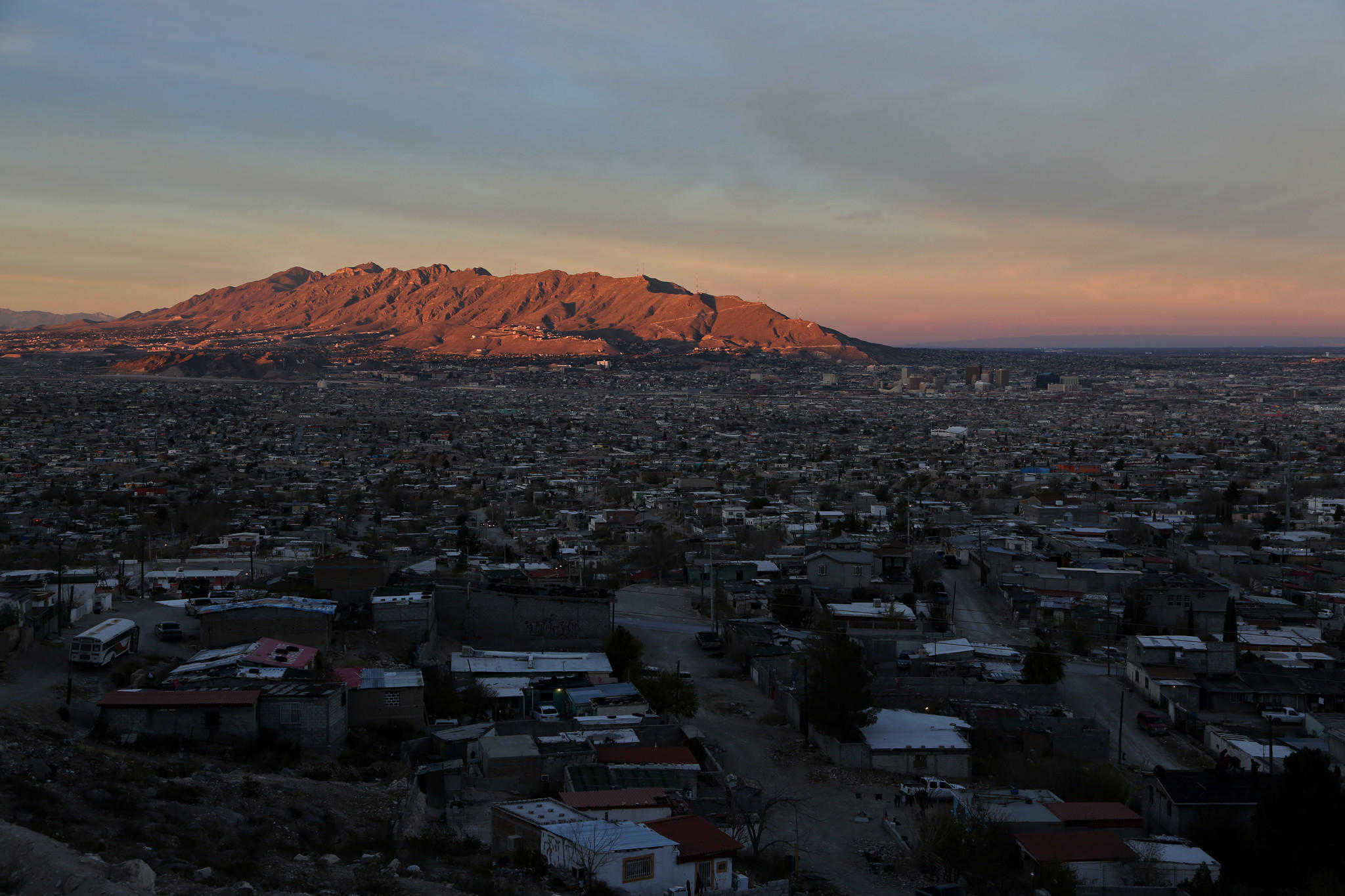 The sun sets over Juarez, Mexico, where many maquiladoras are located.