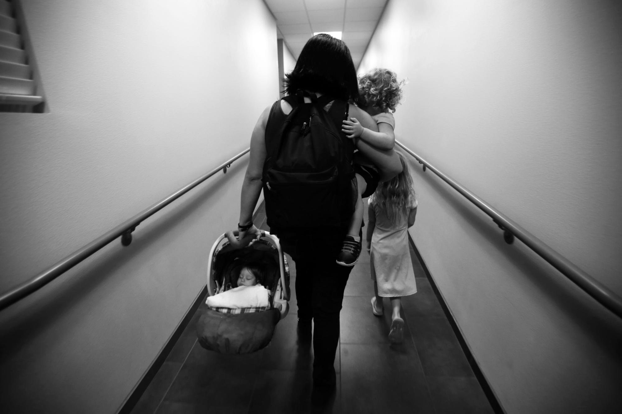 Nadia and her children head back to their room in San Fernando Valley Rescue Mission.