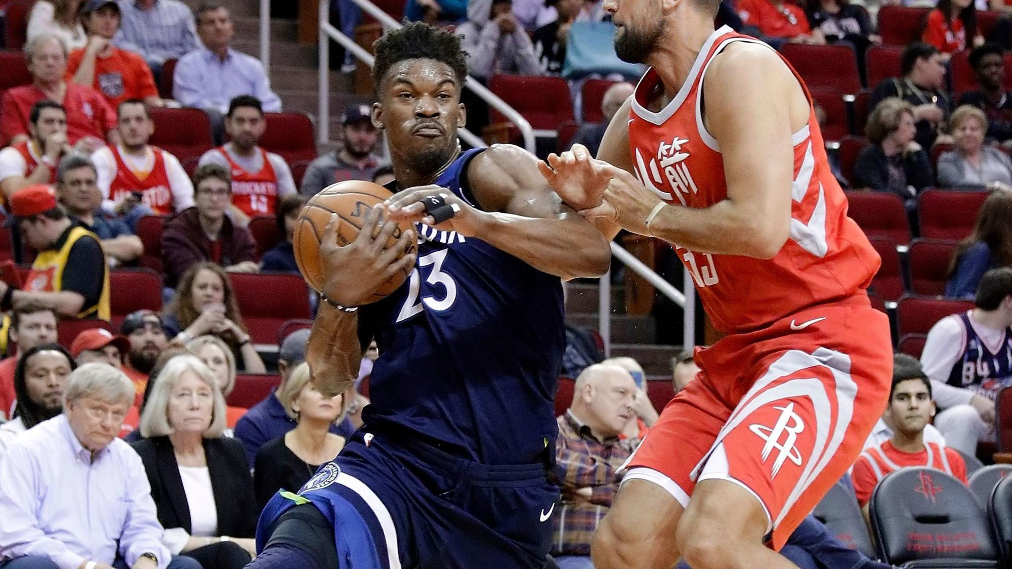 Jimmy Butler leaves Wolves' game with apparent knee injury ...