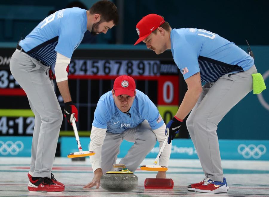 John Shuster, center, John Landsteiner, left, and Matt Hamilton of the U.S. during the men's curling final. (Javier Etxezarreta/EPA-EFE/REX)