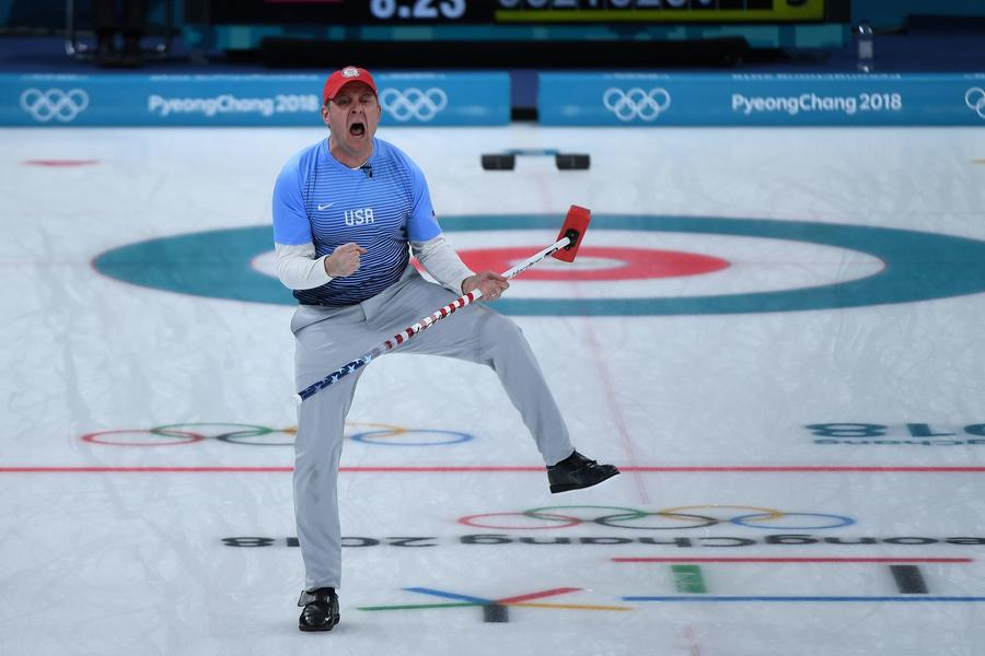 John Shuster of the United States celebrates a point during the gold-medal game in men's curling. (Wang Zhao/Getty Images)