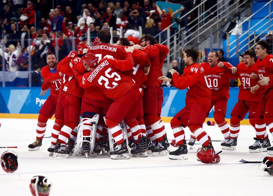 Russians celebrate the winning goal. (Larry W. Smith / EPA / Shutterstock)
