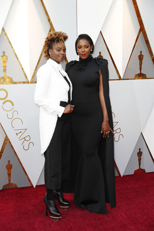 Dee Rees arrives at the Oscars with her partner, Sarah M. Broom. (Jay L. Clendenin)