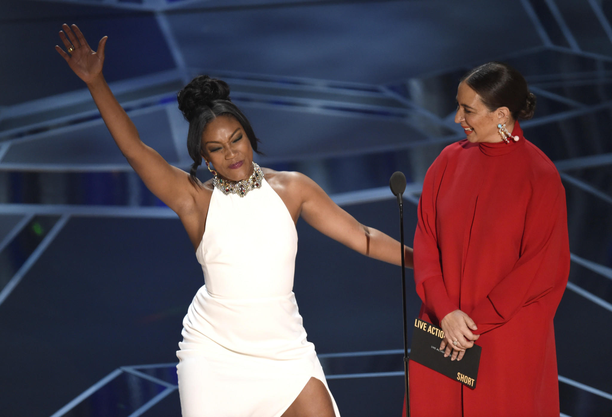 Tiffany Haddish, left, and Maya Rudolph onstage at the Oscars. (Chris Pizzello / Associated Press)