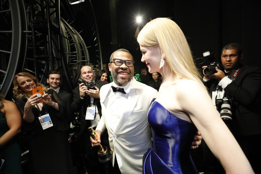 Jordan Peele, who won the Oscar for original screenplay, with presenter Nicole Kidman backstage. (Al Seib / Los Angeles Times)