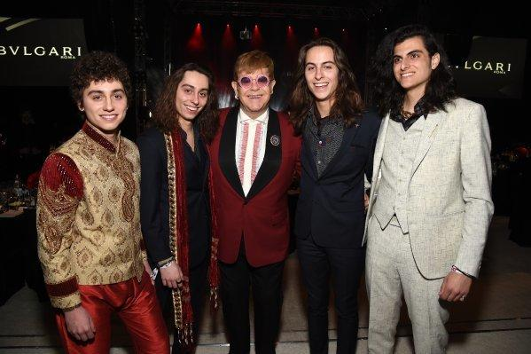 Elton John, center, and members of hard-rock band Greta Van Fleet at his AIDS Foundation dinner and concert on Sunday. (Michael Kovac / Getty Images)