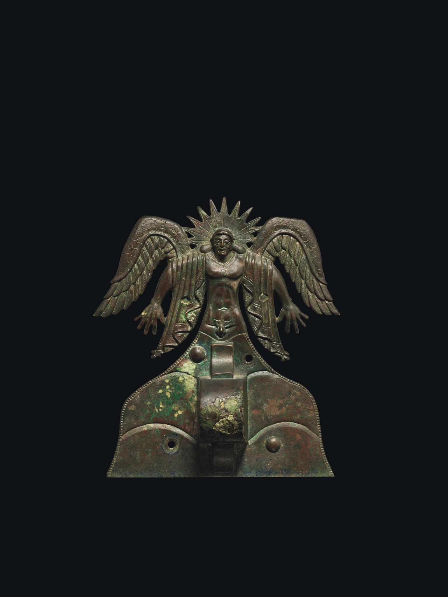 Etruscan bronze applique depicting the Sun God Usil, Etruscan, 500-475 BC.