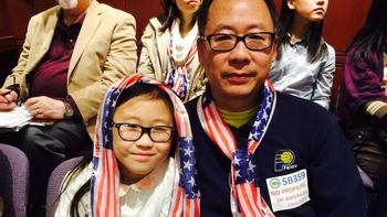 Yuebiao Feng and daughter Jessica, 8, came to the legislative hearing Thursday.