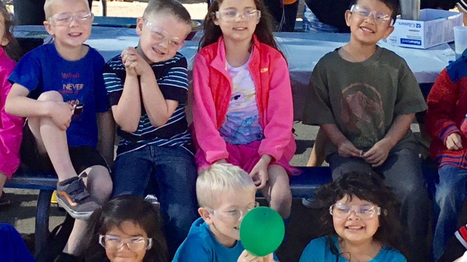 Ramona High School students participating in the Femineer Program teach science experiments to Ramona Elementary School kindergartners.