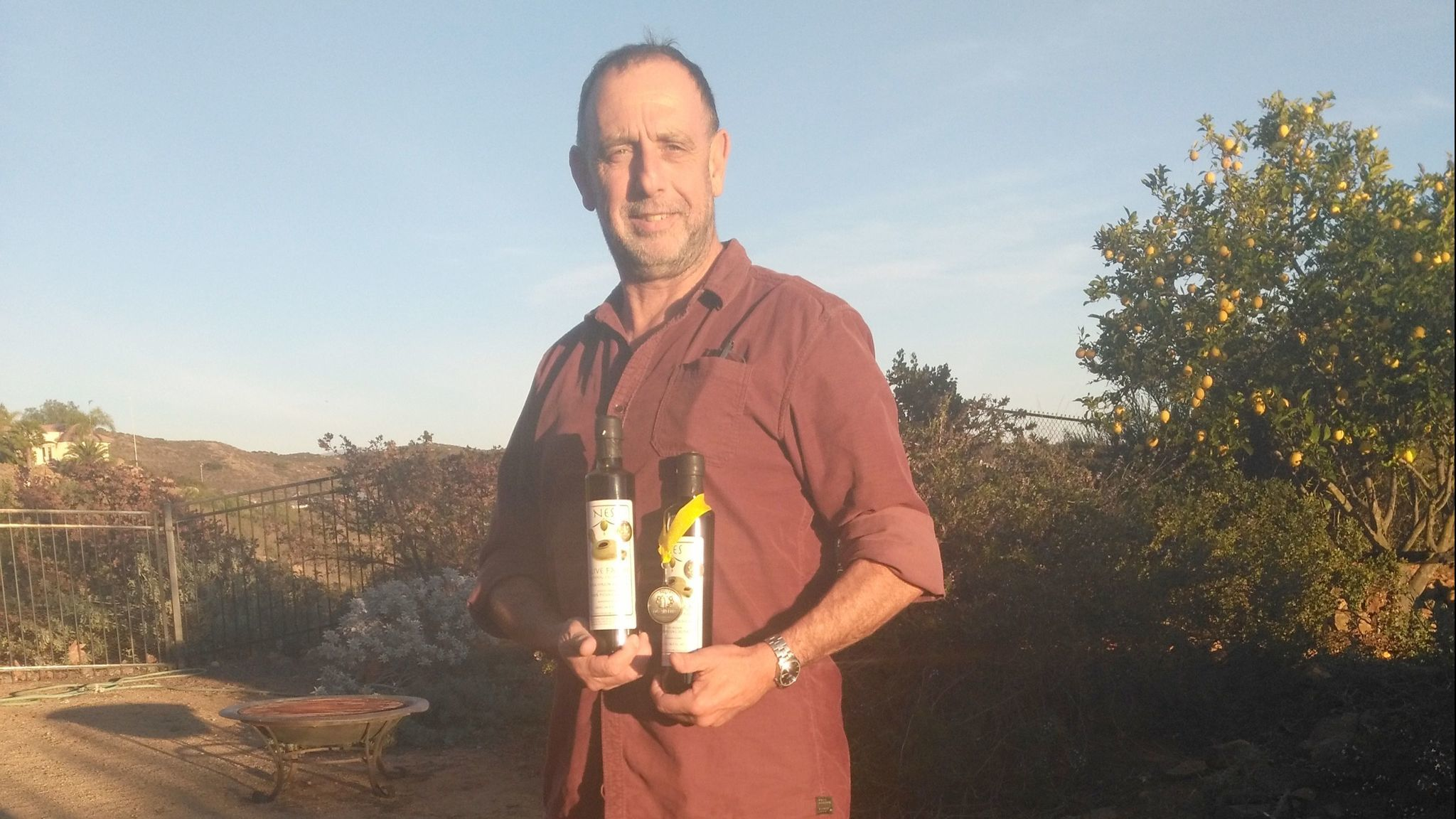 Yigal Ben-Aderet holds bottles of his award-winning olive oil. Only about 300 bottles of the oil were produced on his NES Olive Farm in 2017.