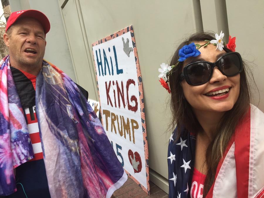 John Turano and his daughter, Bianca, wrap themselves in flags while waiting for President Trump in downtown Los Angeles. (Genaro Molina / Los Angeles Times)