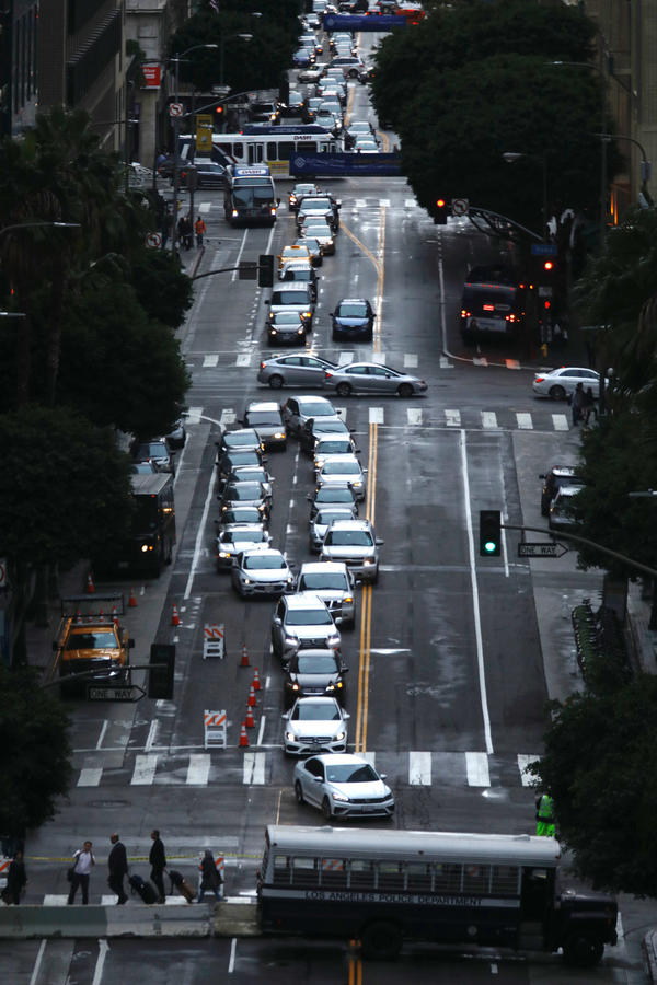 7th Street traffic is blocked by an LAPD bus a block away from the Intercontinental Hotel where President Trump will be staying in downtown. (Genaro Molina / Los Angeles Times)