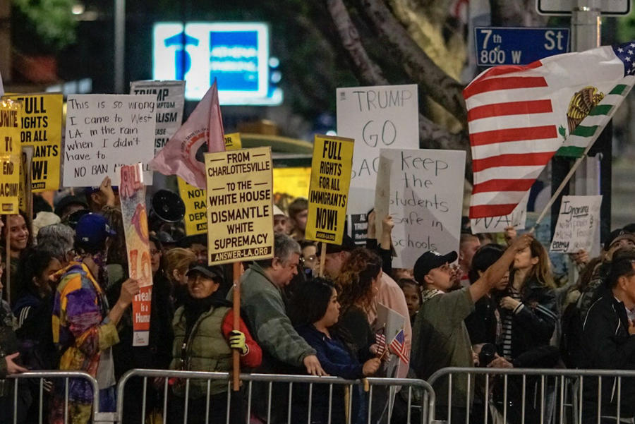 Anti-Trump protesters gather outside the InterContinental Los Angeles Downtown Hotel at 7th and Figueroa streets (Kent Nishimura / Los Angeles Times)
