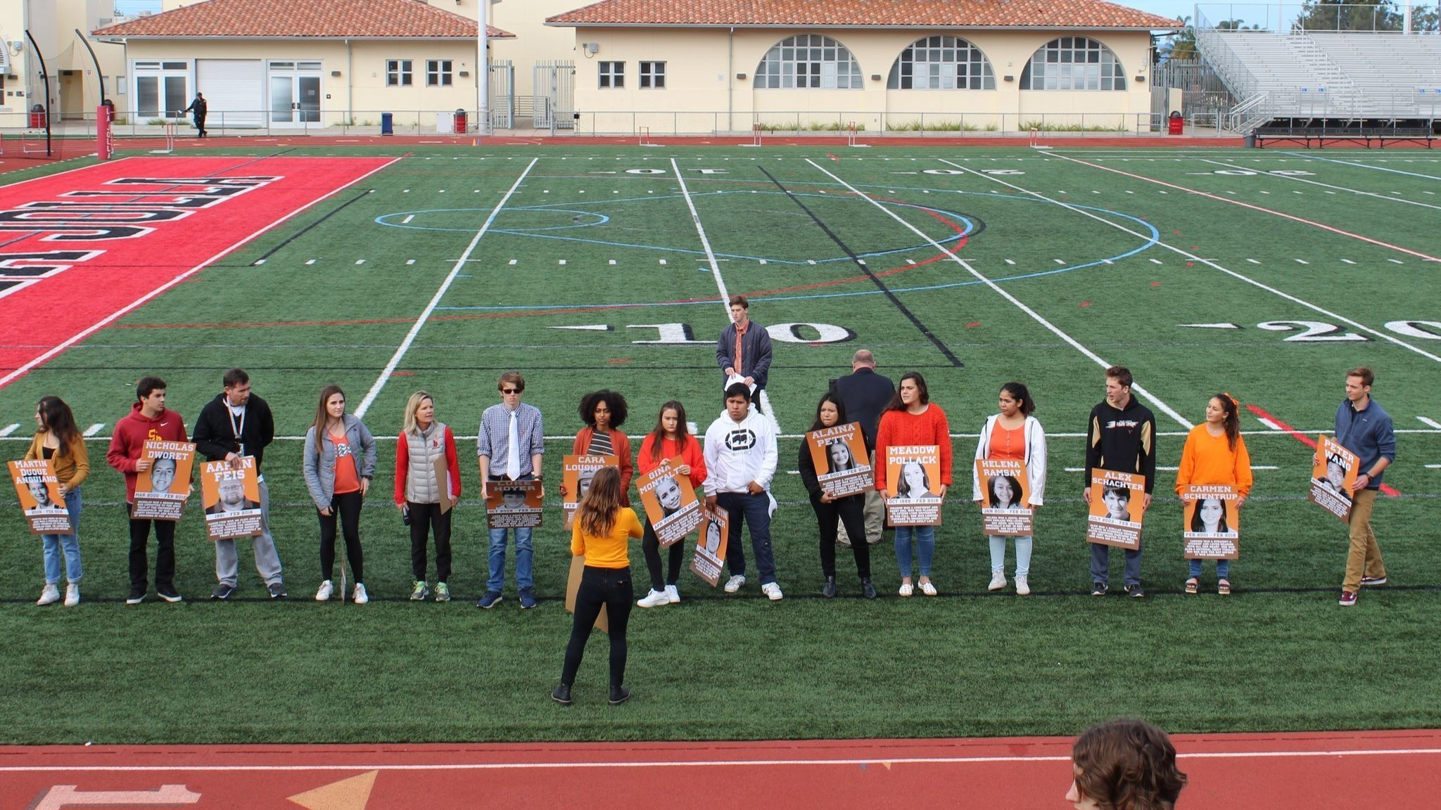 LJHS students hold up signs commemorating the Marjory Stoneman Douglas High School victims.