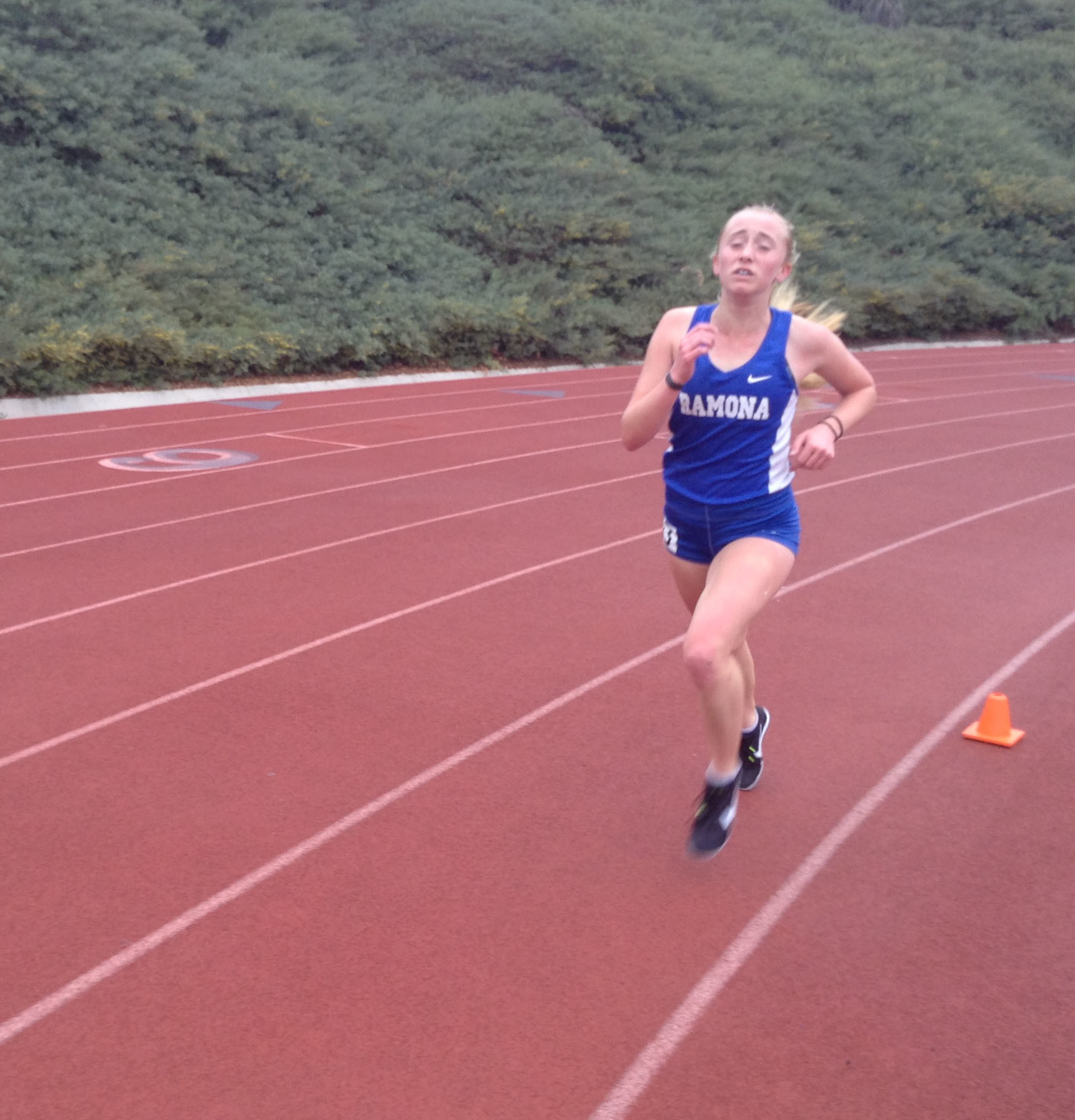 Amy Brown finishes the 3200 with a personal best time of 11:51.85 for fourth place in the Bronco Invitational.