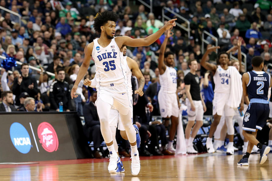 Duke's  Marvin Bagley III celebrates making a three-point shot against Rhode Island during the second half Saturday. (Rob Carr / Getty Images)