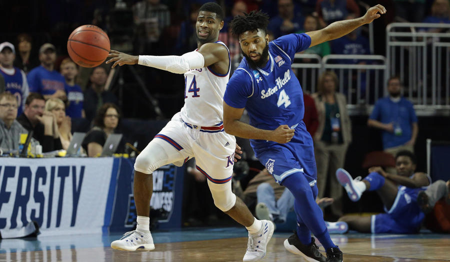 Kansas' Malik Newman drives against Seton Hall's Eron Gordon in the first half. (Jeff Gross / Getty Images)