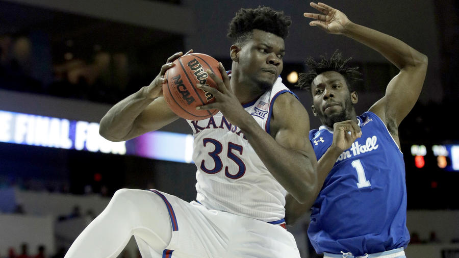 Kansas center Udoka Azubuike (35) grabs a rebound against Seton Hall forward Michael Nzei (1) during the second half of a second-round game. (Orlin Wagner / Associated Press)