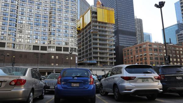 Parking lots disappearing in ride-sharing era as downtown construction booms | Chicago Tribune