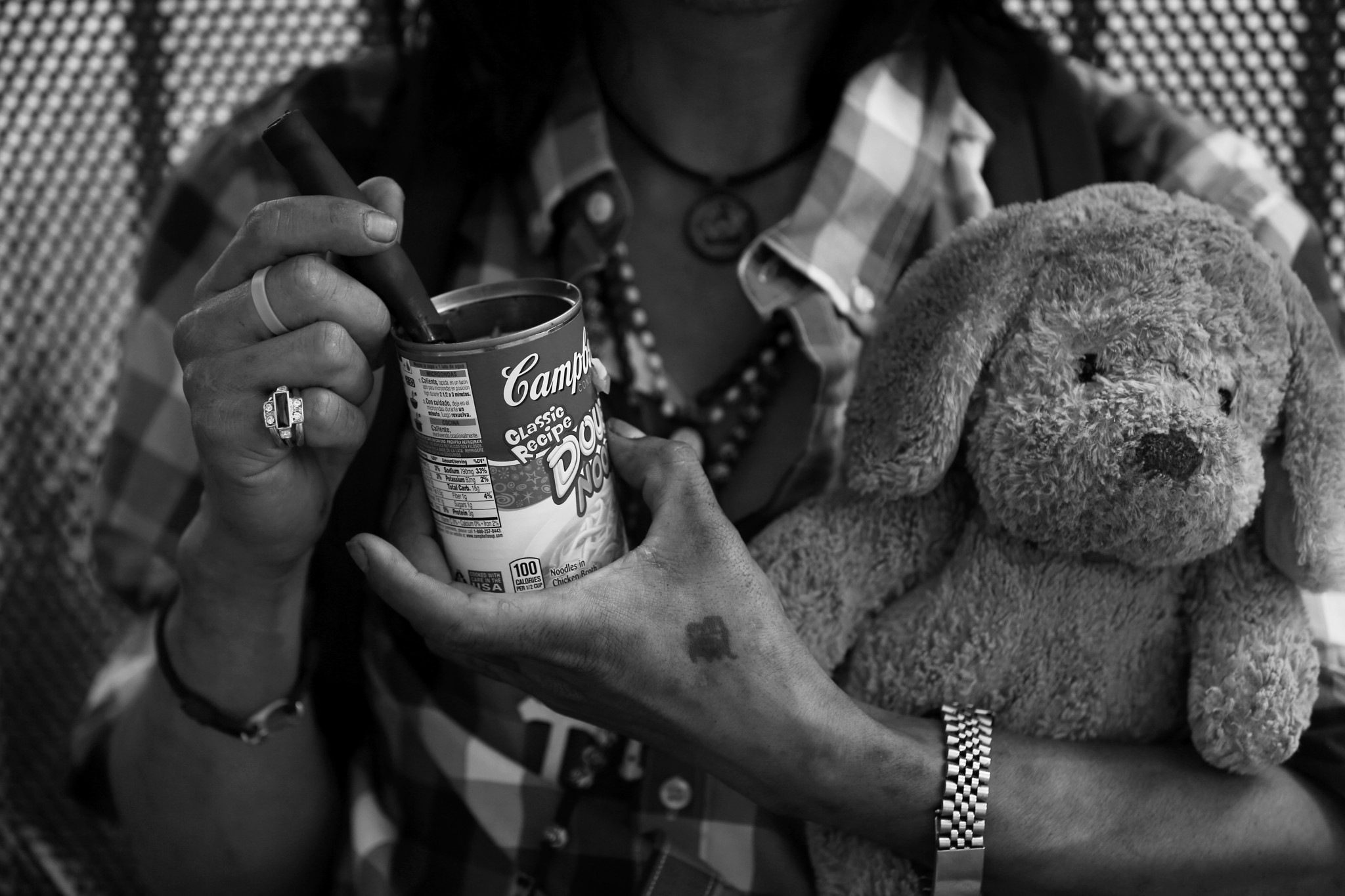 LOS ANGELES, CA OCTOBER 26, 2017: A homeless man eats dinner out of a Campbell's Soup can while he c