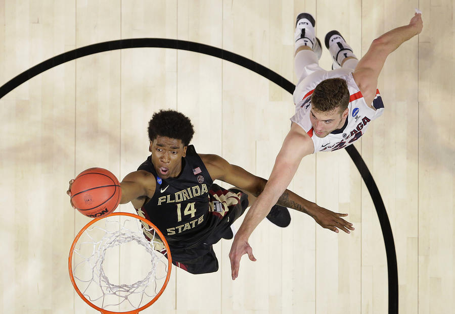 Florida State guard Terance Mann drives past Gonzaga forward Corey Kispert during the second half of their Sweet 16 game. (Alex Gallardo / Associated Press)
