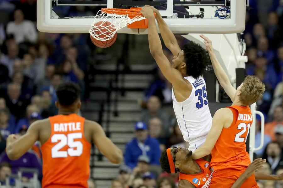 Duke forward Marvin Bagley III dunks the ball against Syracuse during the second half Friday night. (Streeter Lecka / Getty Images)