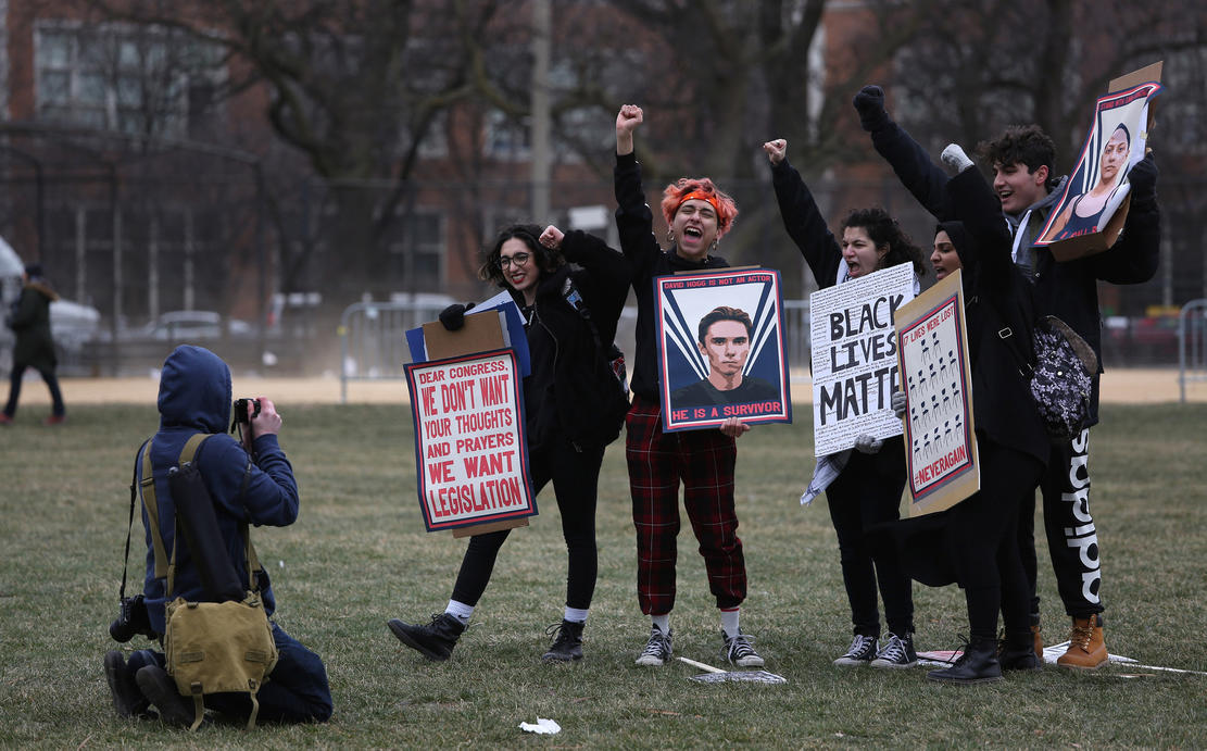 People pose for a photographer after participating in the March for Our Lives protest at Union Park on March 24, 2018, in Chicago. — Photograph: Abel Uribe/Chicago Tribune.