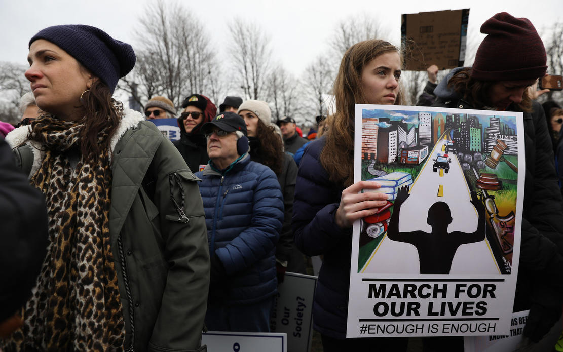 Kathleen Wright, left, Sofi Penglase, center, and Erika Grinius, right, listen to student speakers at Union Park before the March for Our Lives protest on March 24, 2018, in Chicago. — Photograph: Abel Uribe/Chicago Tribune.