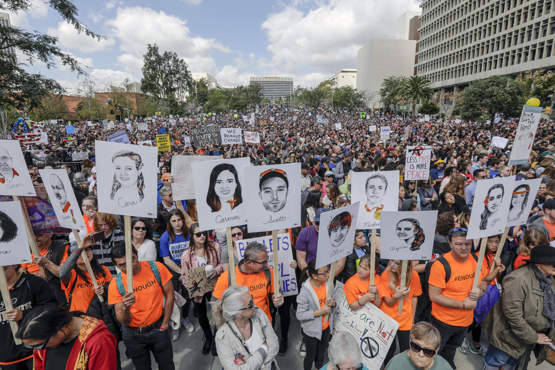 Marchers in Los Angeles carry portraits of the 17 who were killed in the Parkland, Florida shooting. The portraits were drawn by Gracie Pekrul, 16, a student of Simi Valley Oak Park Independent School. — Photograph: Irfan Khan/Los Angeles Times.