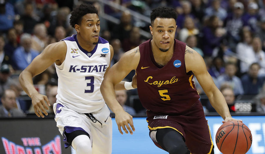 Loyola Chicago's Marques Townes dribbles past Kansas State's Kamau Stokes. (David Goldman / Associated Press)